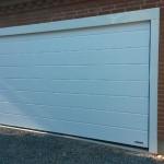 Garageport med indfarvet inddækning