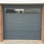 Garageport med visuel vinduesparti